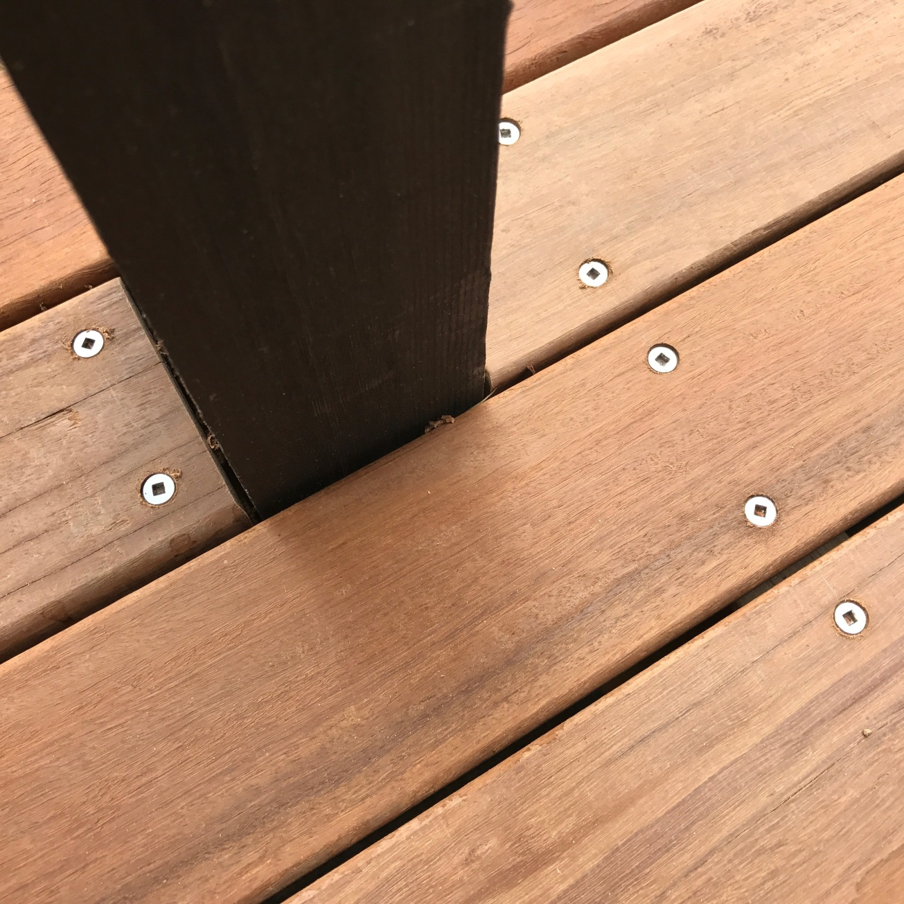 December 2016: Decking and post detail. We chose Iron Bark for its hardness, strength, and durability around water. And the great price we were able to obtain