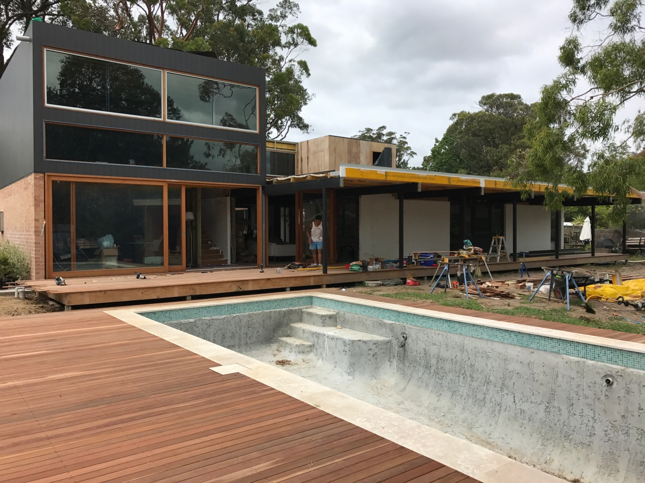 December 2016: These days, pools can't be filled until glass fencing is completed and certified. We took on an extra carpenter called Matt and together with Kitt, they have done an extraordinarily precise job of beautiful decking around the pool. After the glass fencing, the pool will be lined with a fine screed pebble in Arctic White so that the water will be truly blue, and then set. Filling the pool will help harden the surface. We decided against mosaic through out because those tiles are beautiful but expensive enough to feed a small African nation. We felt we didn't need it. Read more about the pool in the pool blog post.