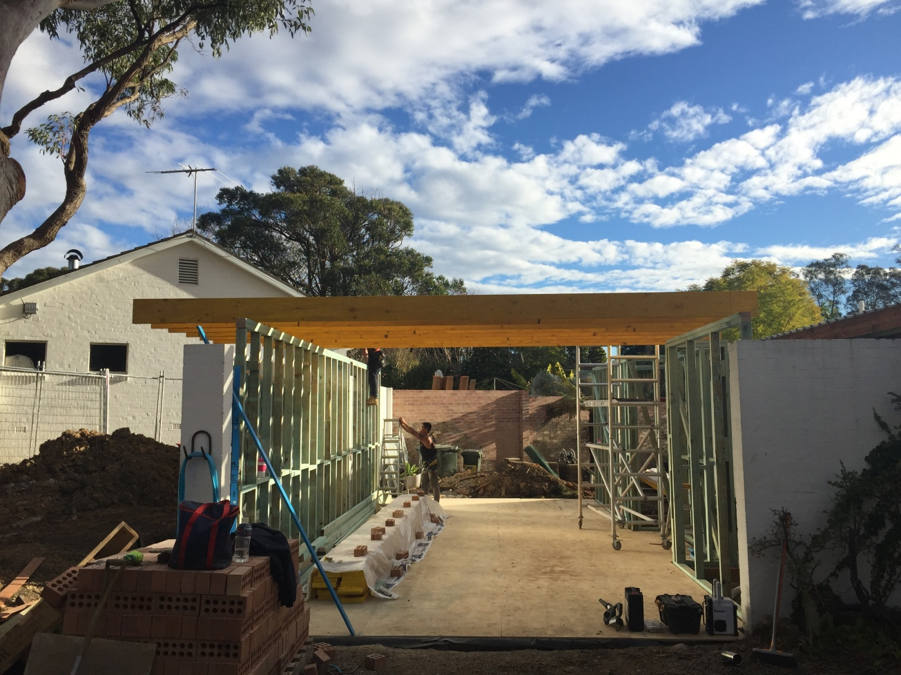 August 2016: With the first part of the extension all framed up and windows in, the team begins construction of the new master bedroom over the old carport. This shows the slab has been laid and the original brick wall has been reinforced ready for framework. 9 metres of concrete was quite something. As the carports in most P&S homes were at the side or front of the property, you can see ours here at the front and adjacent to the neighbour's garage. Luckily we are not looking down on their home.