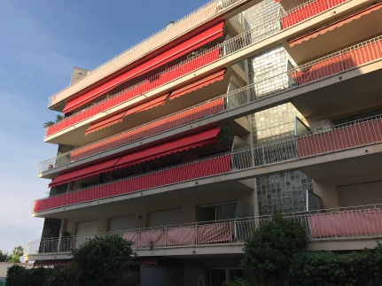 Modernism in Antibes. Quite common to have long brightly coloured shades on all of these apartment buildings. Similar styles in Geneva as well.